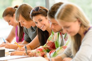 bigstock-Students-writing-at-high-schoo-37050733-300x199